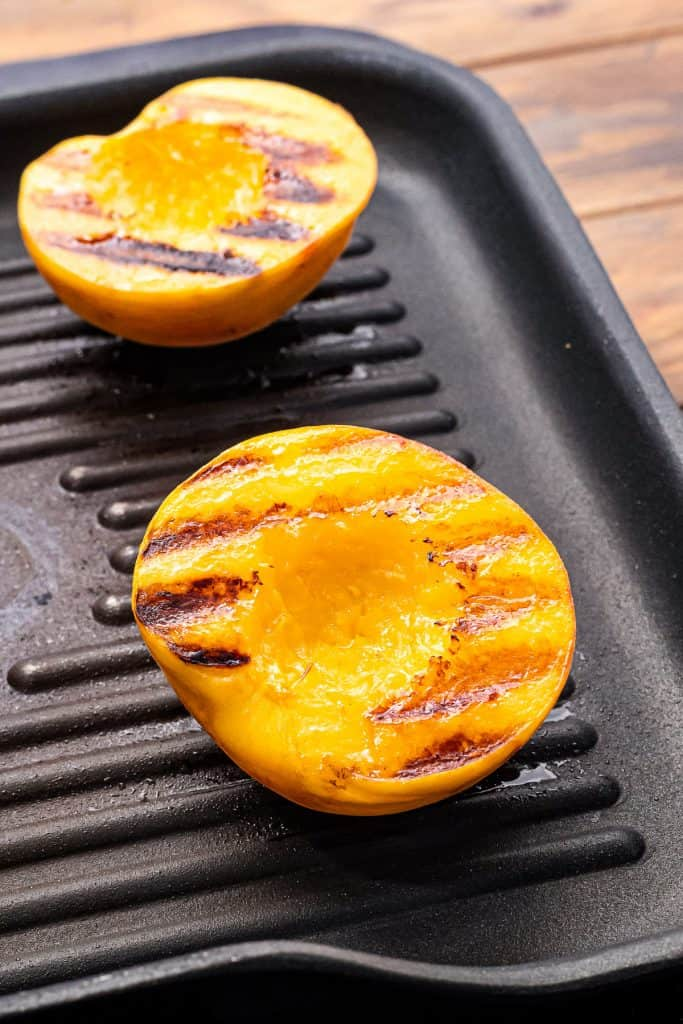 Peaches with grill marks laying on grill pan