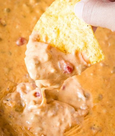 Dip scooping Smoked Queso Dip