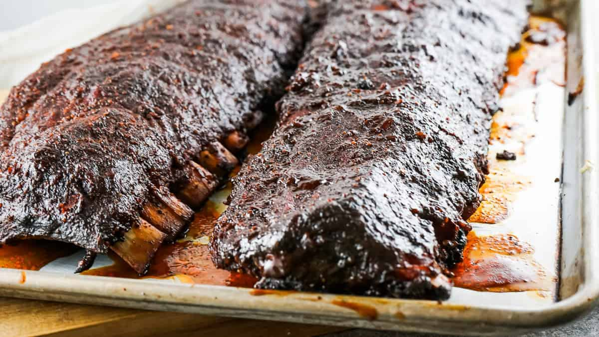 Sheet pan with spicy smoked ribs on it