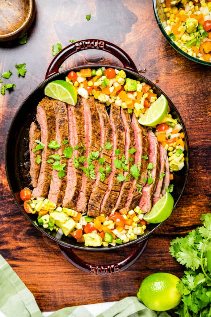 Overhead image of Flank Steak with Corn Salsa in cast iron skillet