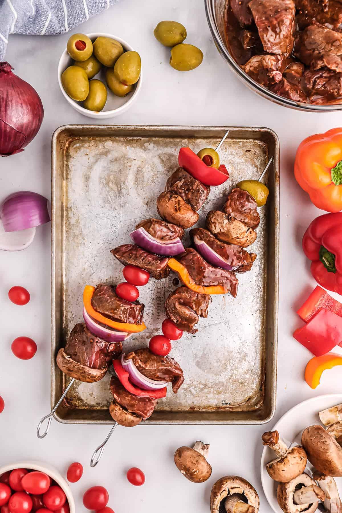 Steak Kabobs on baking sheet before smoking