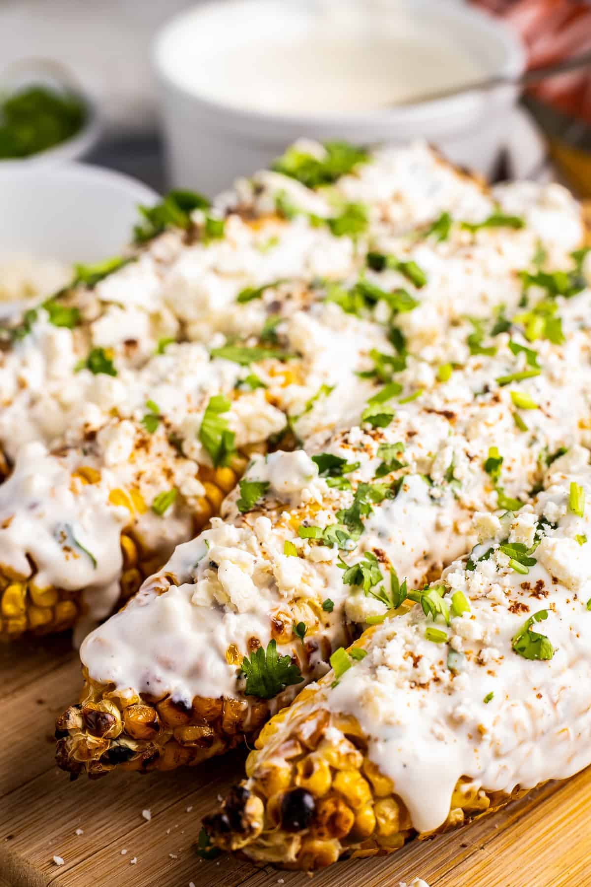 Mexican Street Corn on a wooden cutting board