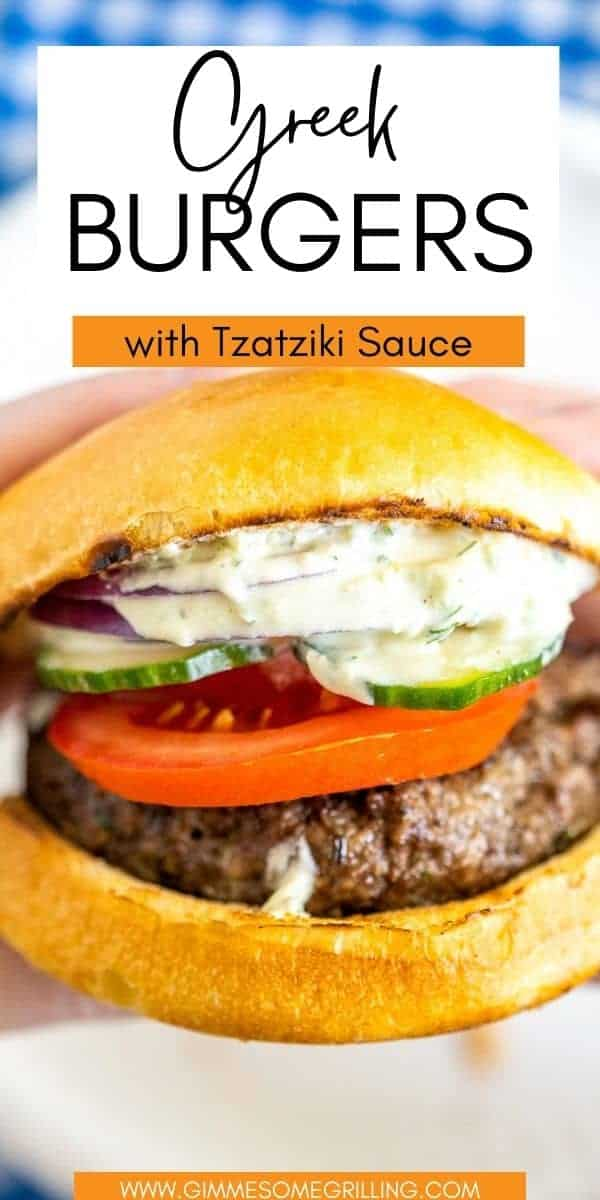 Greek Burger with Tzatziki is the perfect summer dinner! Hand pattied Greek Burger with tons of flavor topped with Tzatziki Sauce, onions, feta cheese, tomatoes and cucumbers. Every bit is bursting with flavor!  via @gimmesomegrilling