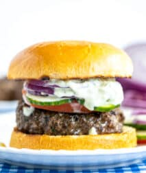 Greek Burger topped with Tzatzki Sauce on bun