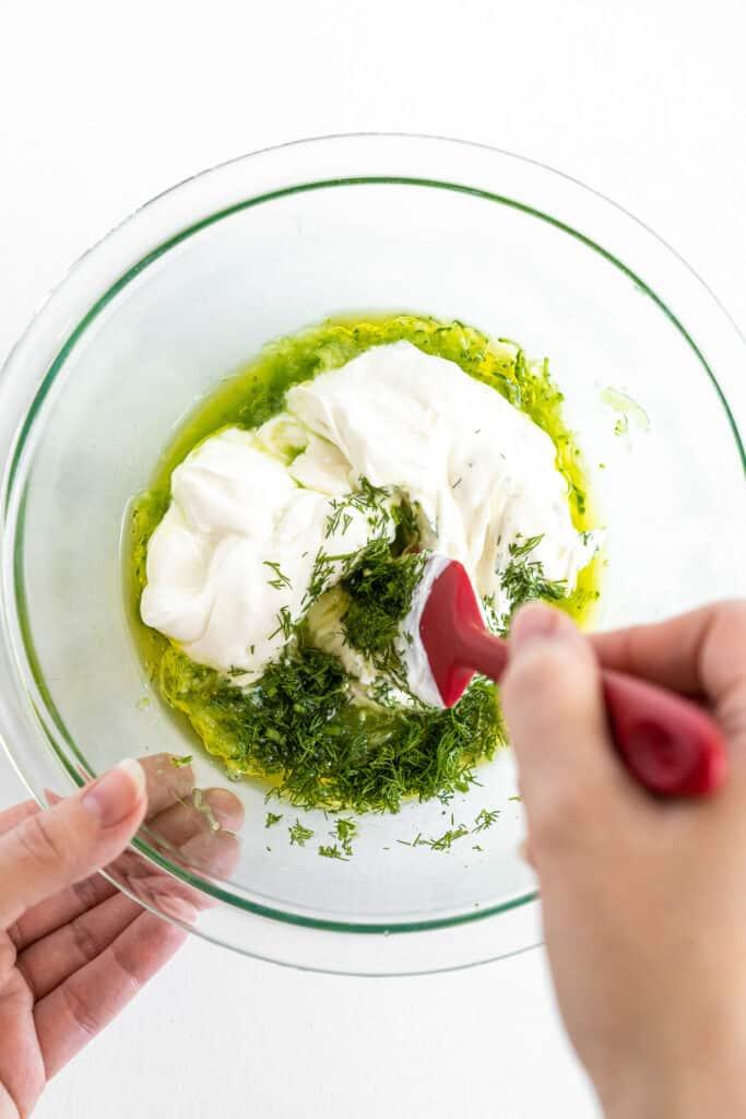 Stirring togehter Tzatziki Sauce ingredients