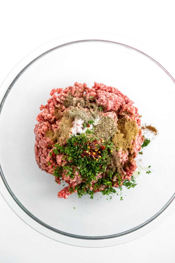 Ground beef mixture in glass bowl for Greek Burgers