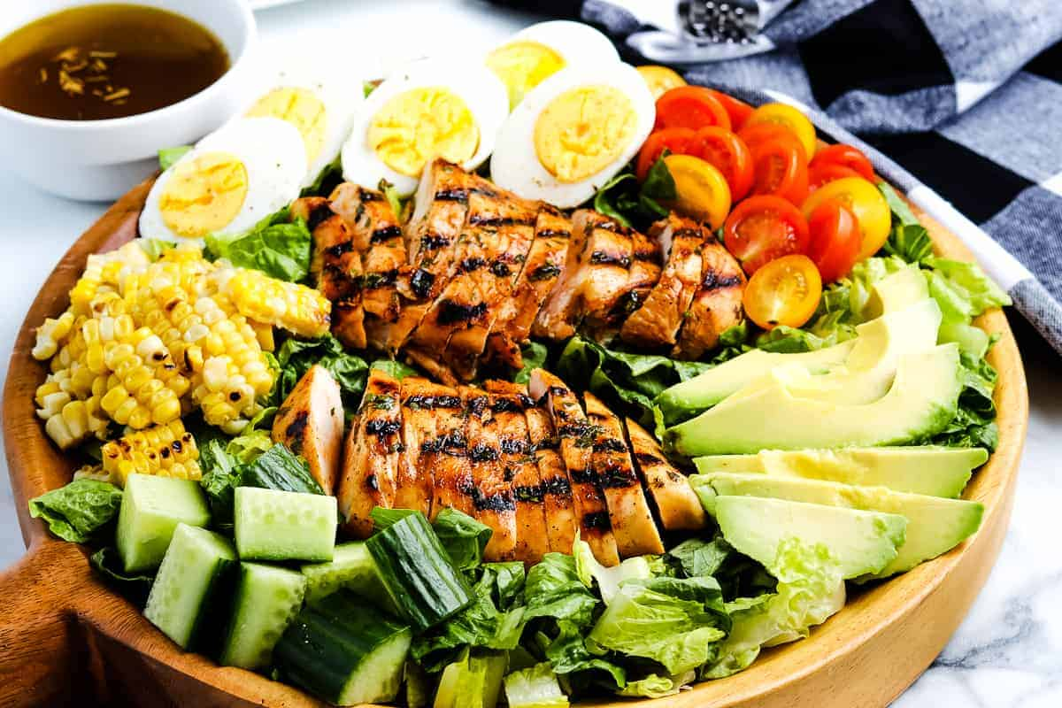 Grilled Chicken Salad closeup with toppings on lettuce