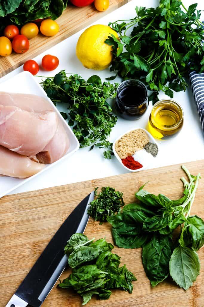 Mincing herbs on cutting board