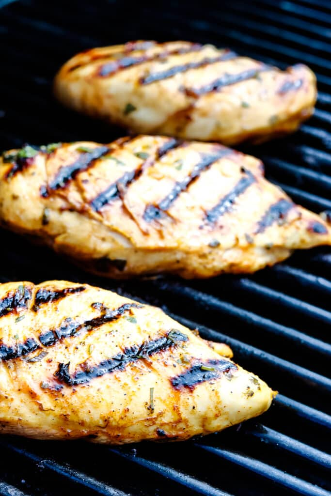 Chicken breasts on grill with grill marks