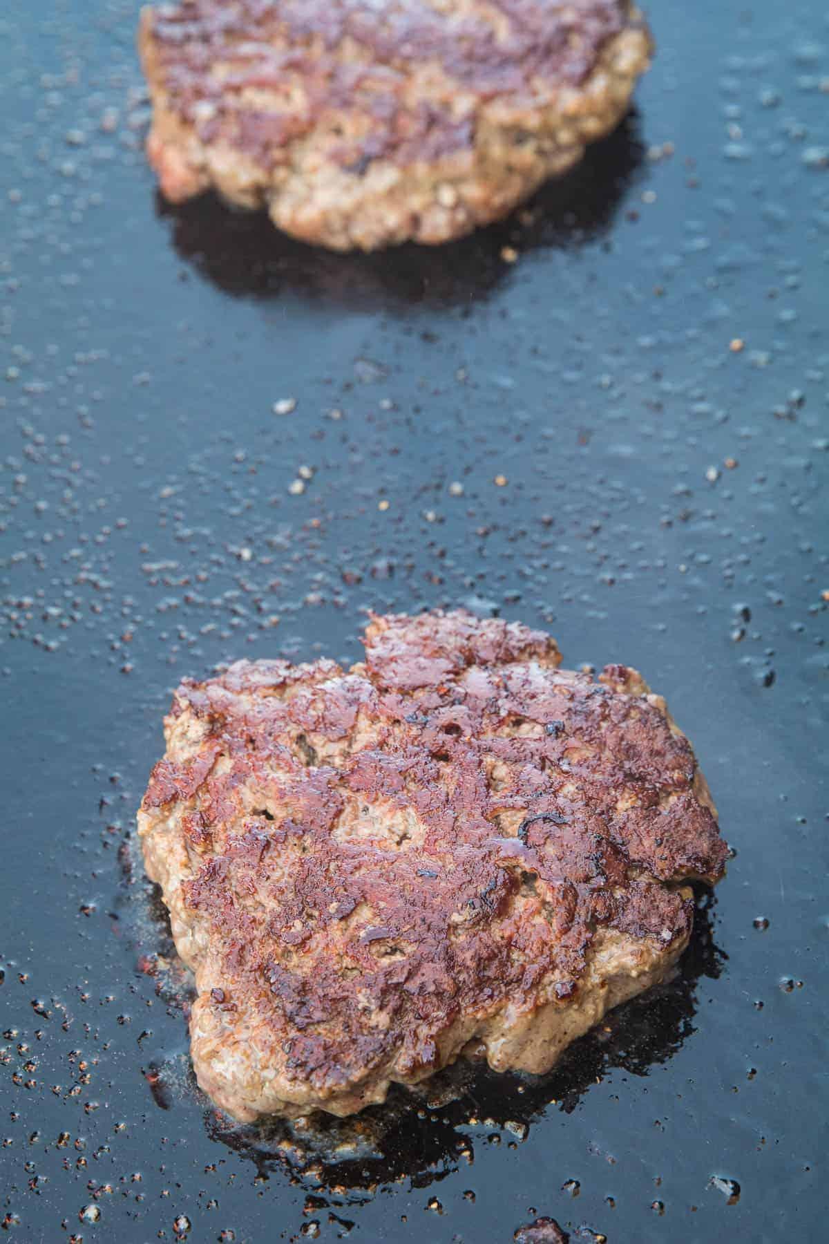 Fried hamburger on griddle
